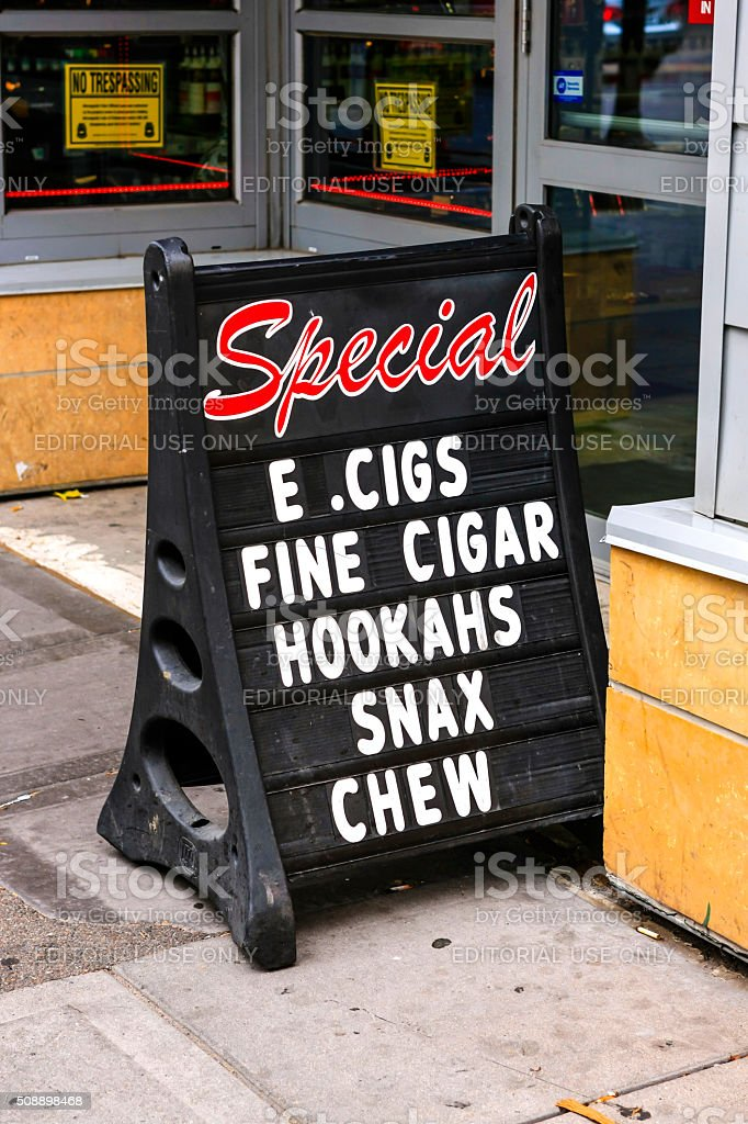 E. Cigs, Fine Cigars, Hookahs, Snax and chew tobacco sign stock photo