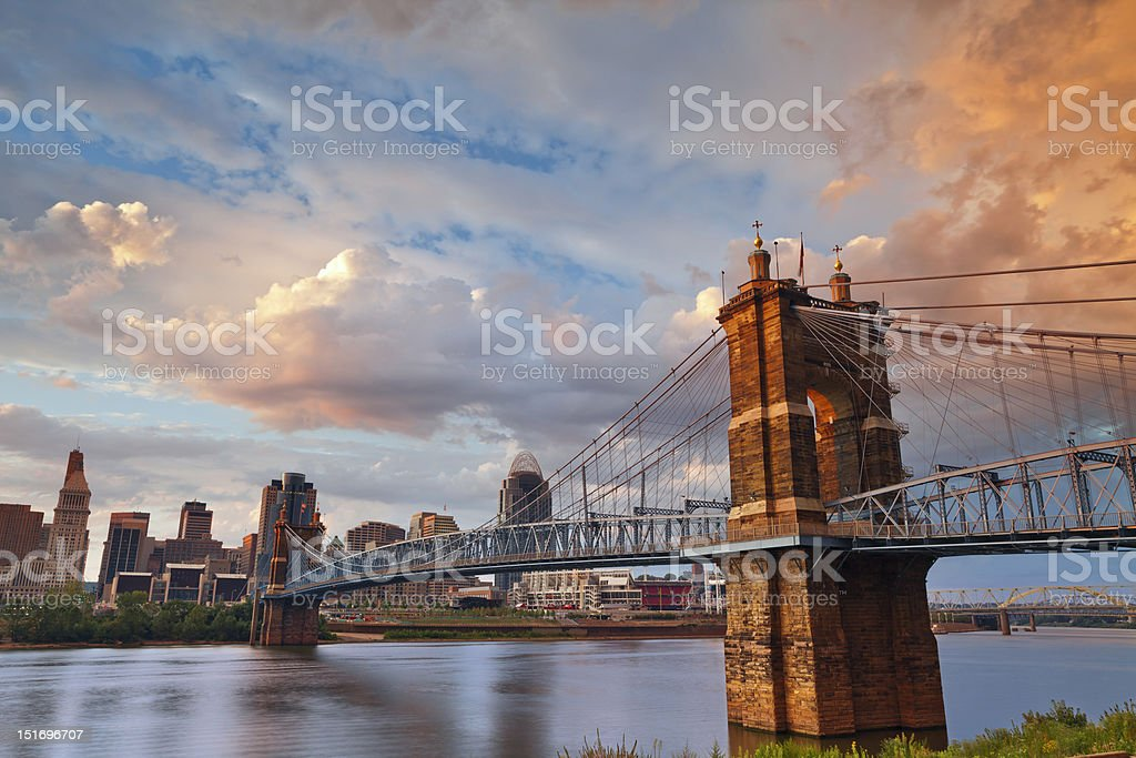 Cincinnati at sunrise watching cars cross the bridge stock photo