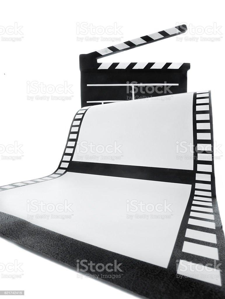 Cinema clapper and film stock photo