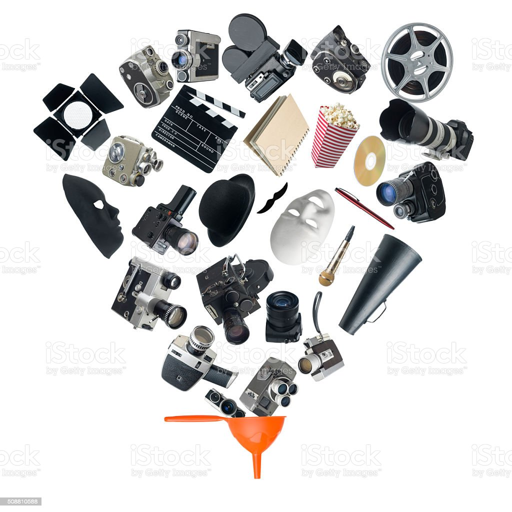 Cinema Equipments Falling Into A Funnel On White Background stock photo