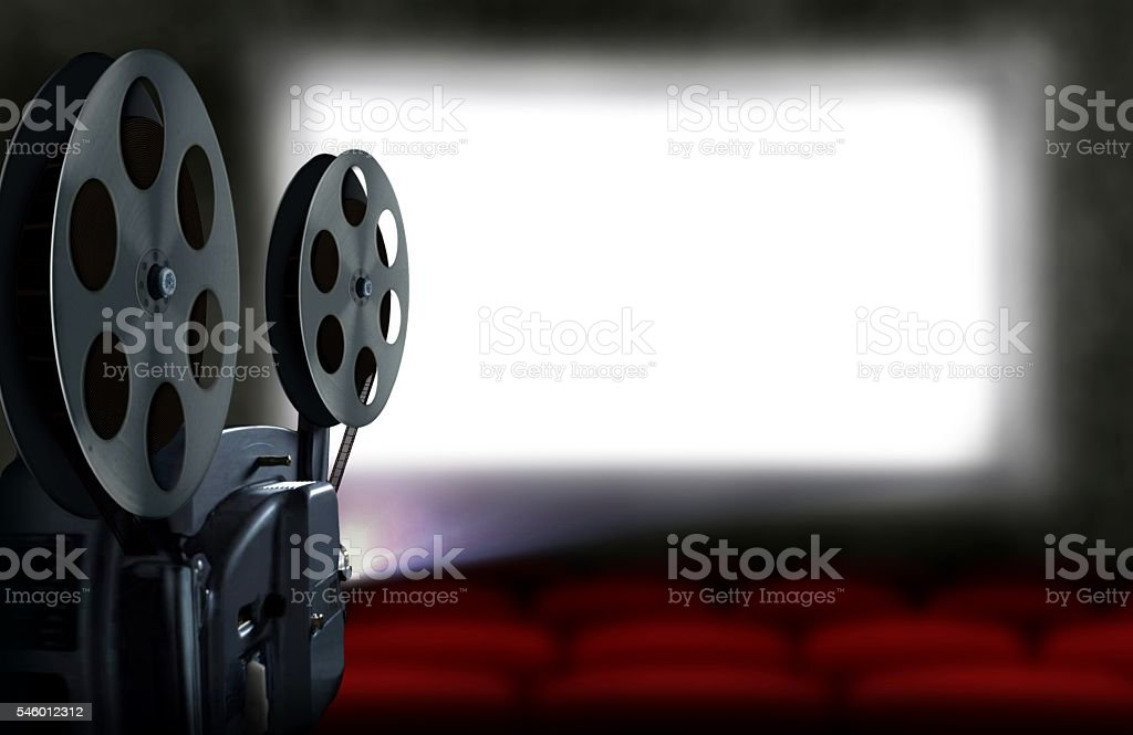 Cinema projector with empty seats stock photo