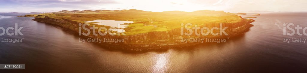 Cinematic aerial shot of the dramatic coastline at the cliffs close to the famous Kilt Rock waterfall ,Skye stock photo