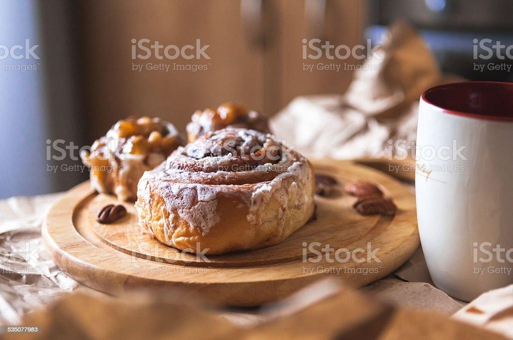 cinnabon with coffee stock photo