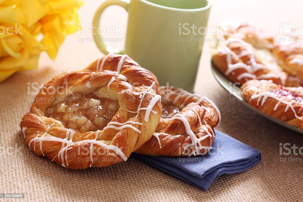 A cinnamon and cheese Danish on a table stock photo