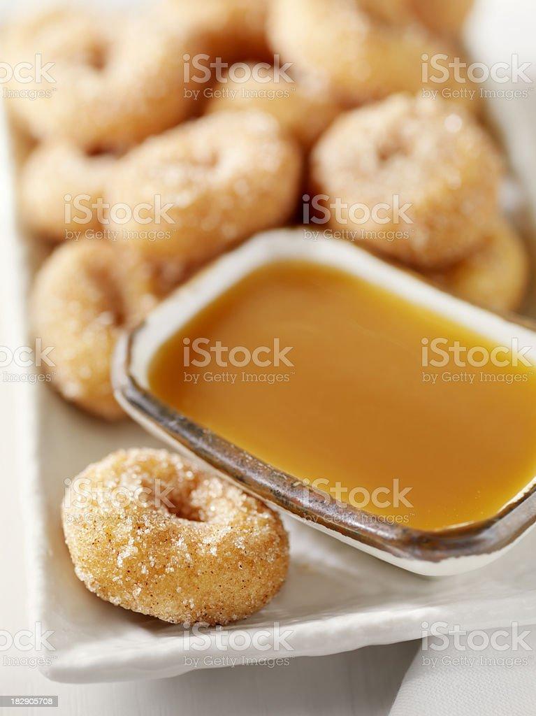 Cinnamon and Sugar Mini Donuts with Caramel Sauce stock photo