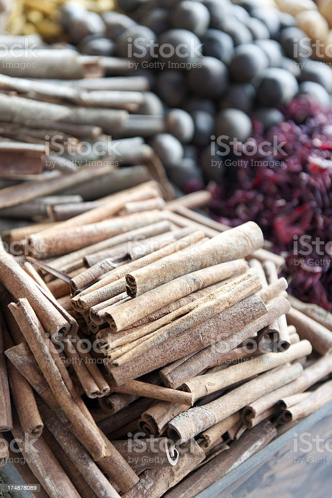 cinnamon and various spices at spice stall stock photo