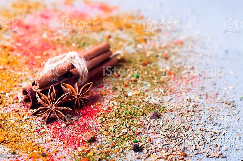 cinnamon, anise lie on scattered spices stock photo