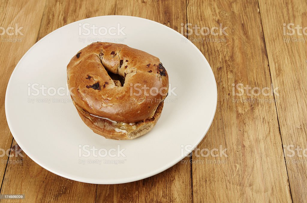 Cinnamon Bagels With Sultanas On Plate royalty-free stock photo