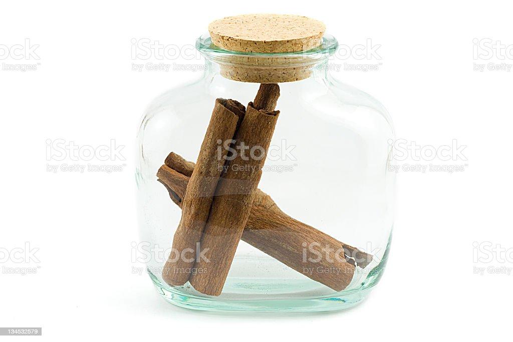 cinnamon bark in the bottle royalty-free stock photo