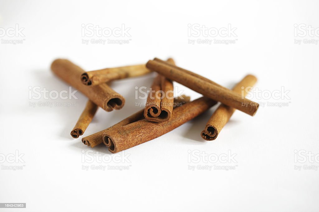 Cinnamon bark stick isolated on white stock photo