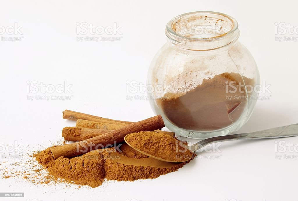 cinnamon barks and powder stock photo