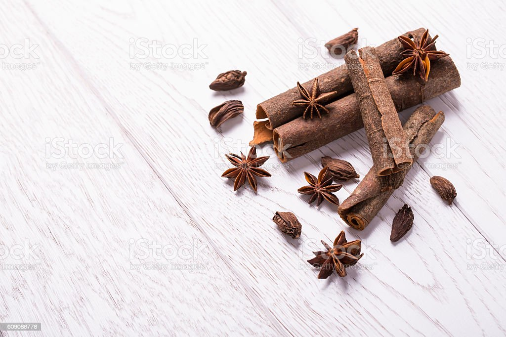 cinnamon,  black cardamom and anise on wooden table stock photo