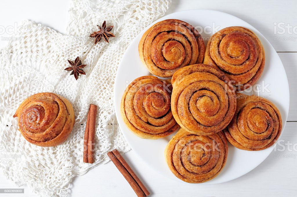Cinnamon bun rolls christmas sweet dessert on white vintage table stock photo