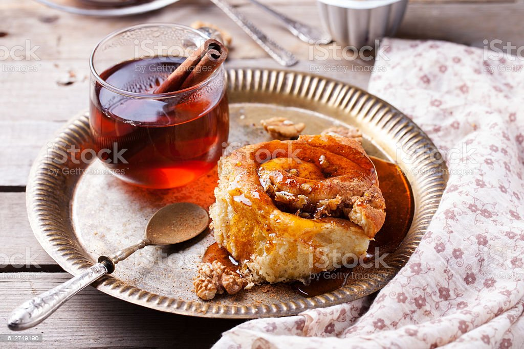Cinnamon bun rolls with syrup and tea stock photo