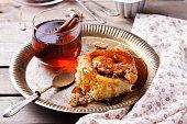 Cinnamon bun rolls with syrup and tea