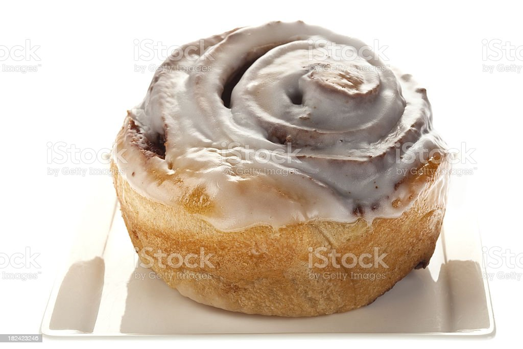 Cinnamon Bun With Icing royalty-free stock photo