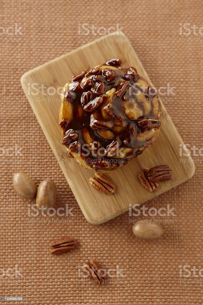 Cinnamon Bun with nuts stock photo