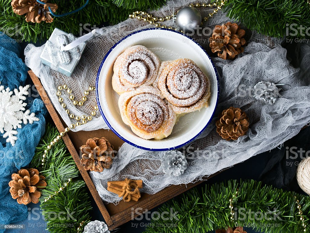 Cinnamon buns and Christmas decorations. Top view still life stock photo