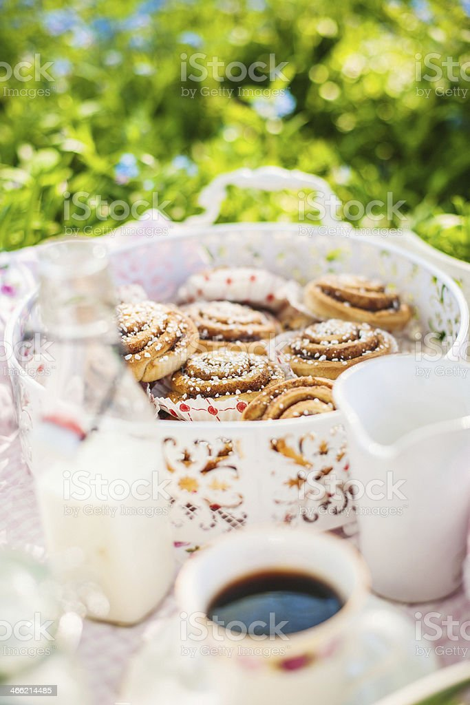 Cinnamon buns and coffee in the summer sun royalty-free stock photo
