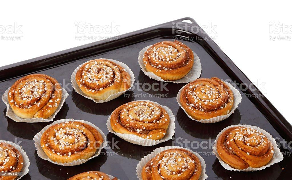 Cinnamon buns on a baking tray stock photo