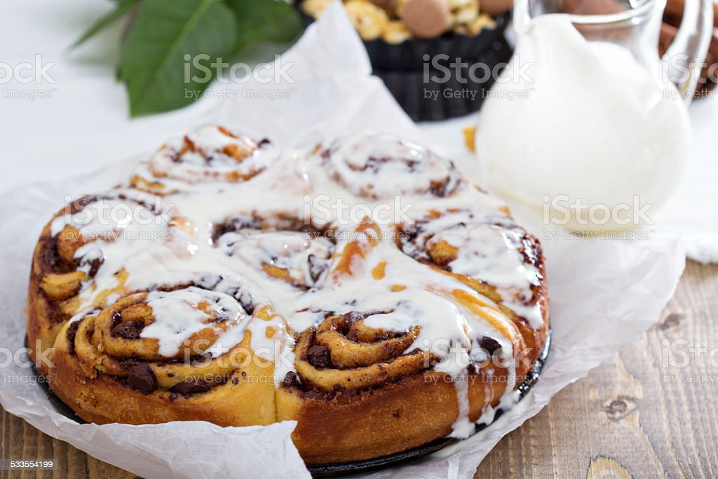 Cinnamon buns with chocolate and cream stock photo