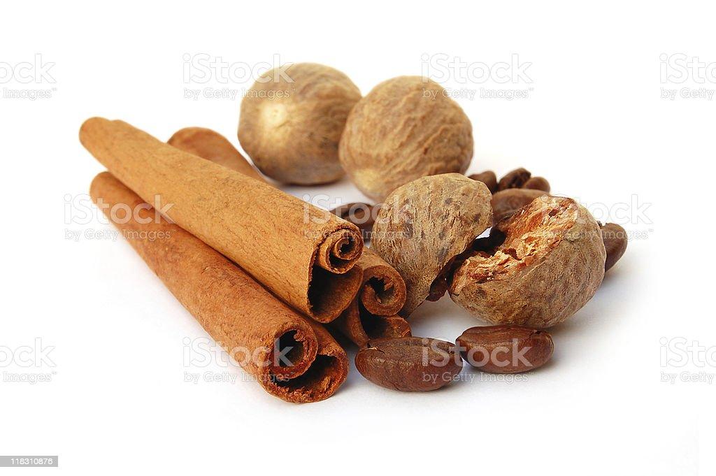 Cinnamon, grains of coffee and nutmeg royalty-free stock photo