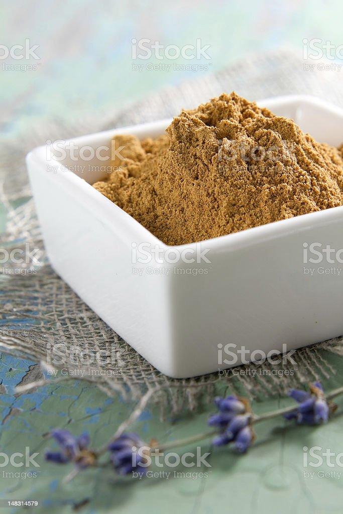 Cinnamon in the white china bowl royalty-free stock photo