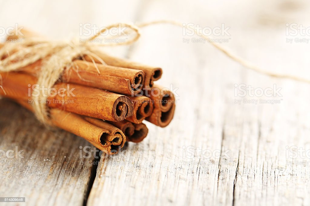 Cinnamon on a grey wooden background stock photo