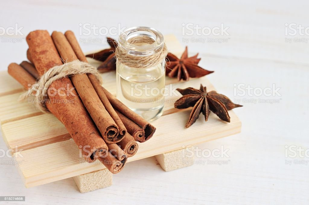Cinnamon or anise essential oil. stock photo