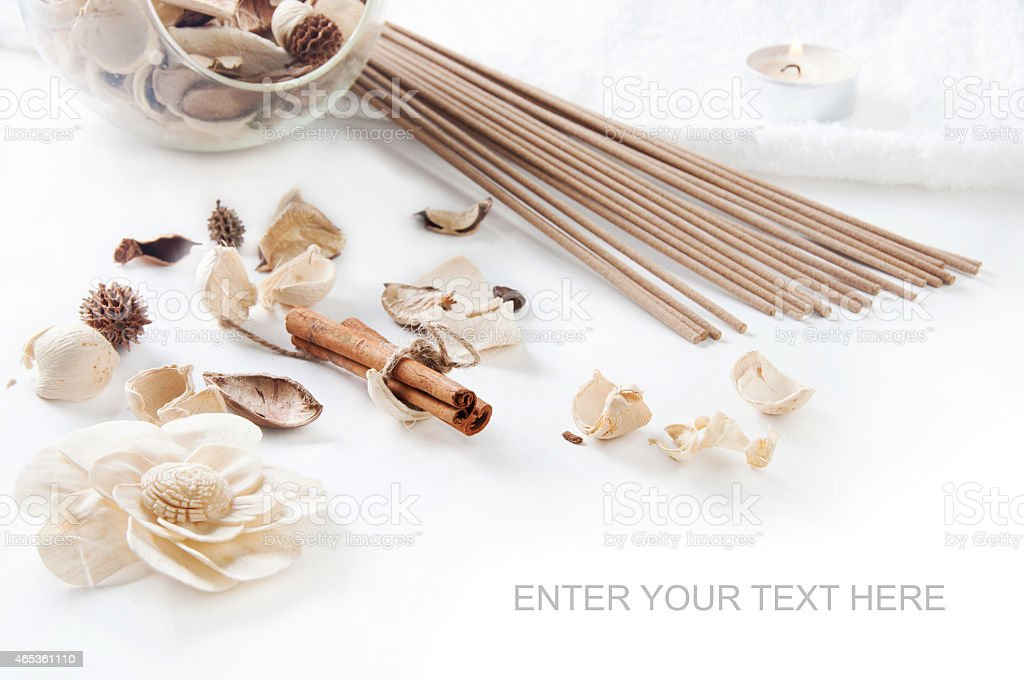 Cinnamon, perfume sticks,  aroma candle and ornamental dried flo stock photo
