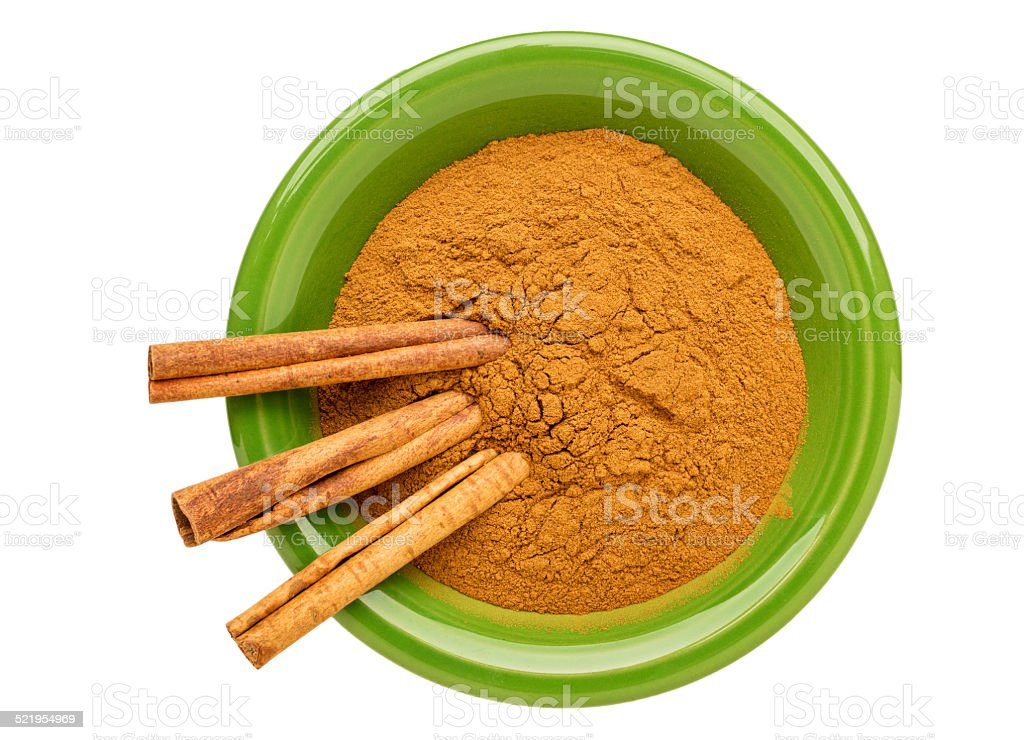 cinnamon (cassia)  powder and sticks stock photo