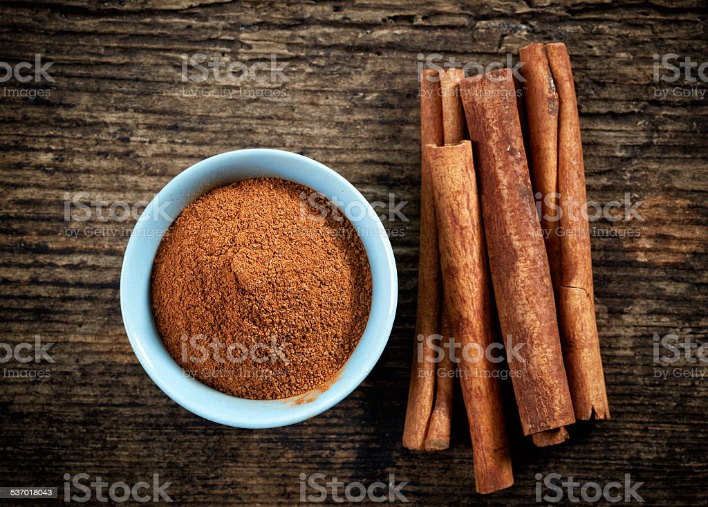 cinnamon powder and sticks stock photo