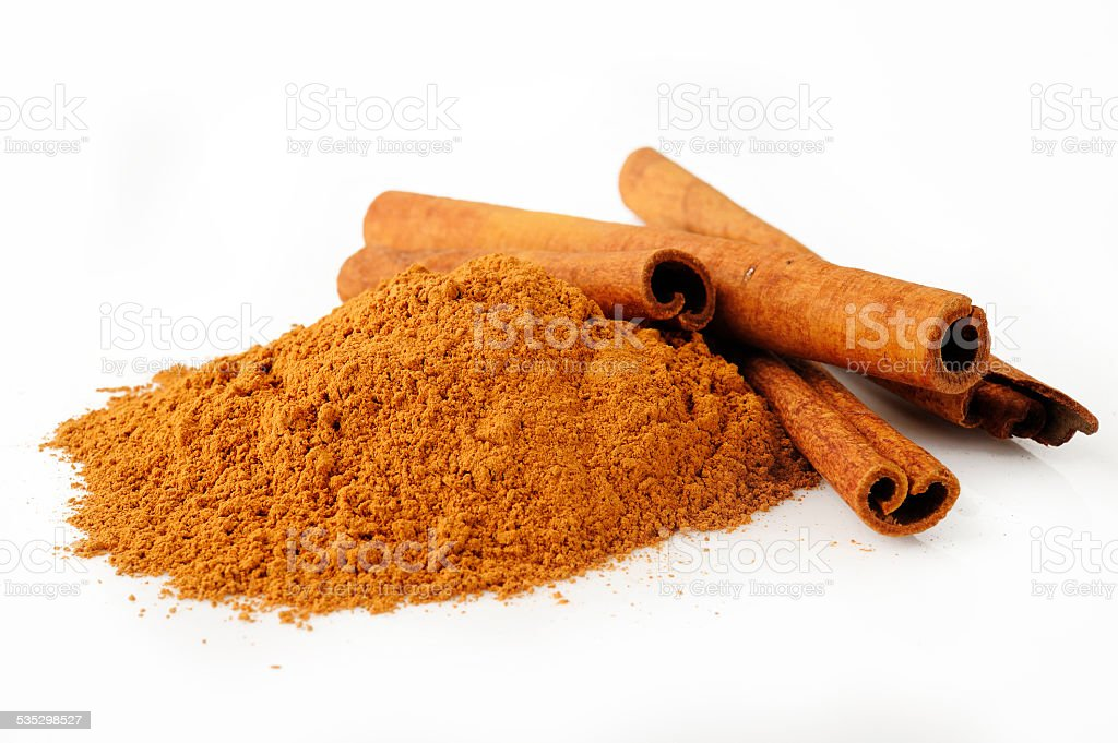 cinnamon powder on white background stock photo