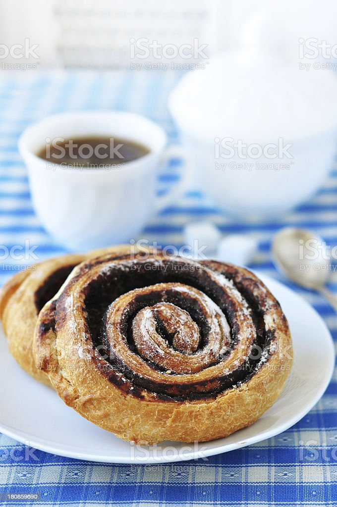 Cinnamon roll and coffee royalty-free stock photo