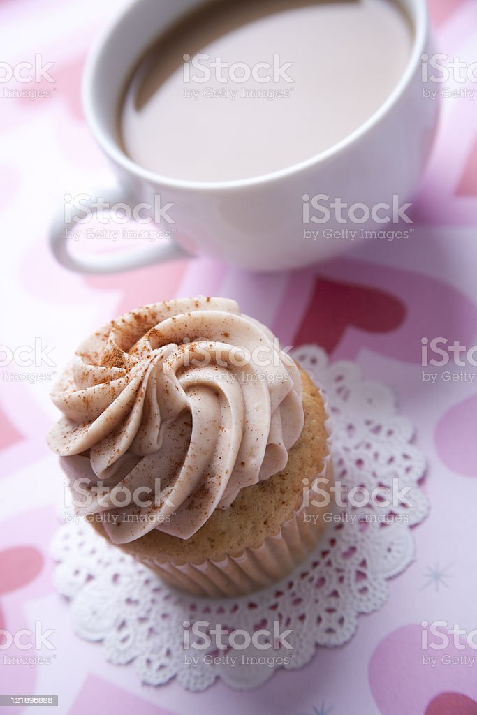 cinnamon spice cupcake and cup of coffee royalty-free stock photo
