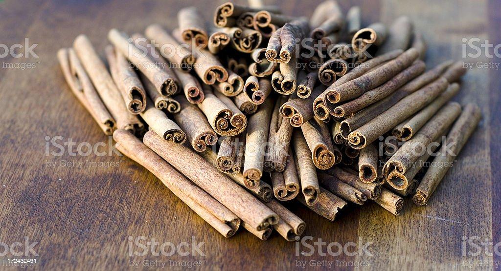 Cinnamon Spice Sticks, Holiday Winter Baking Sepia Background royalty-free stock photo