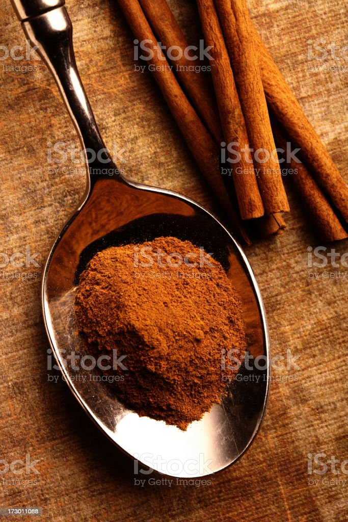 Cinnamon Spoon on Light Ground stock photo