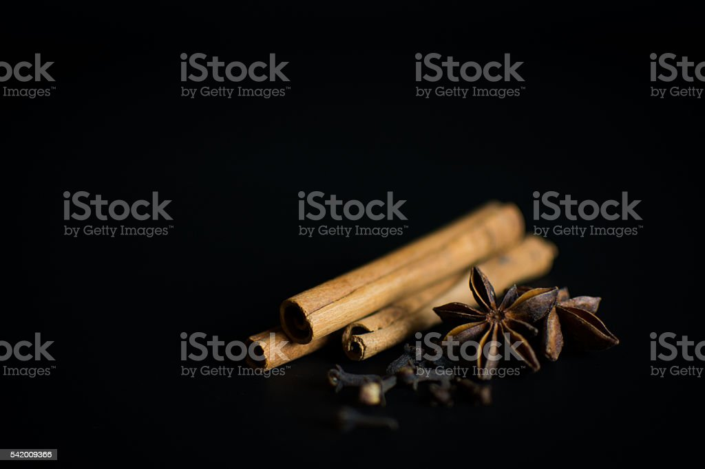 Cinnamon, Star Anise & Cloves on black stock photo