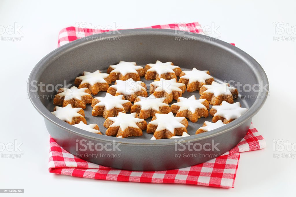 Cinnamon star cookies glazed with frosting stock photo