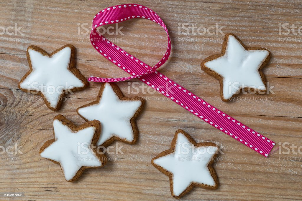 Cinnamon star on wood with gift ribbon stock photo