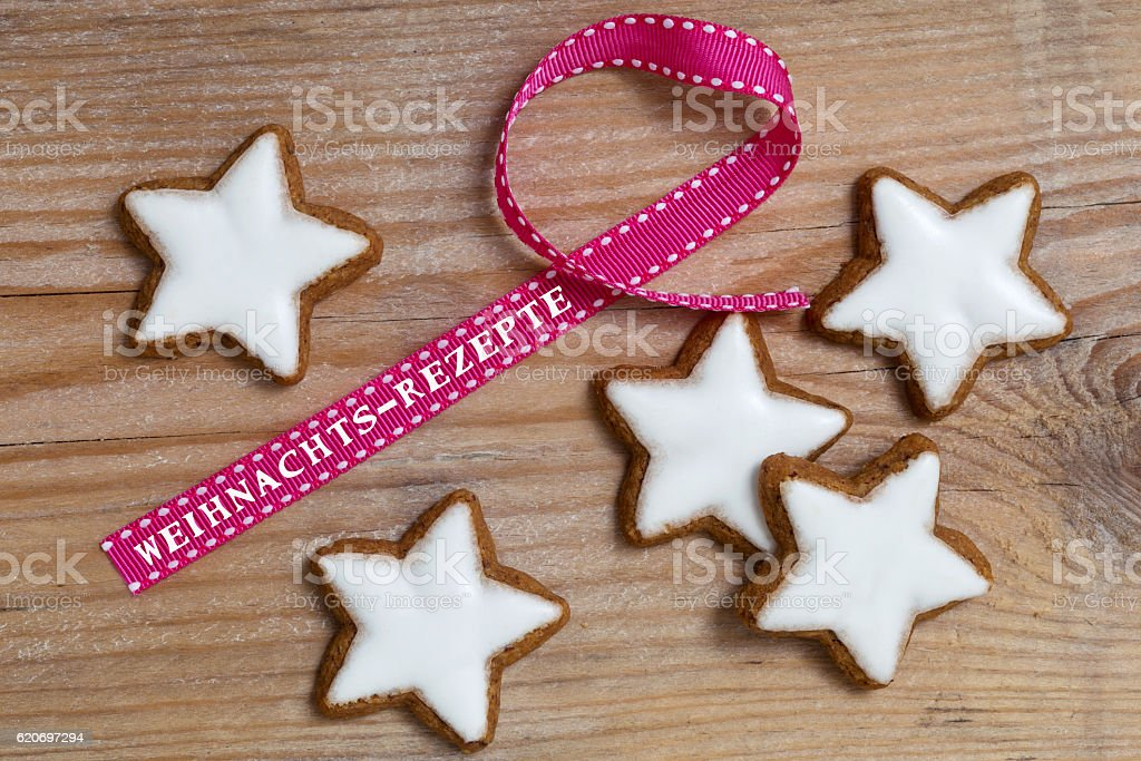 Cinnamon star on wood with Weihnachts - Rezepte stock photo