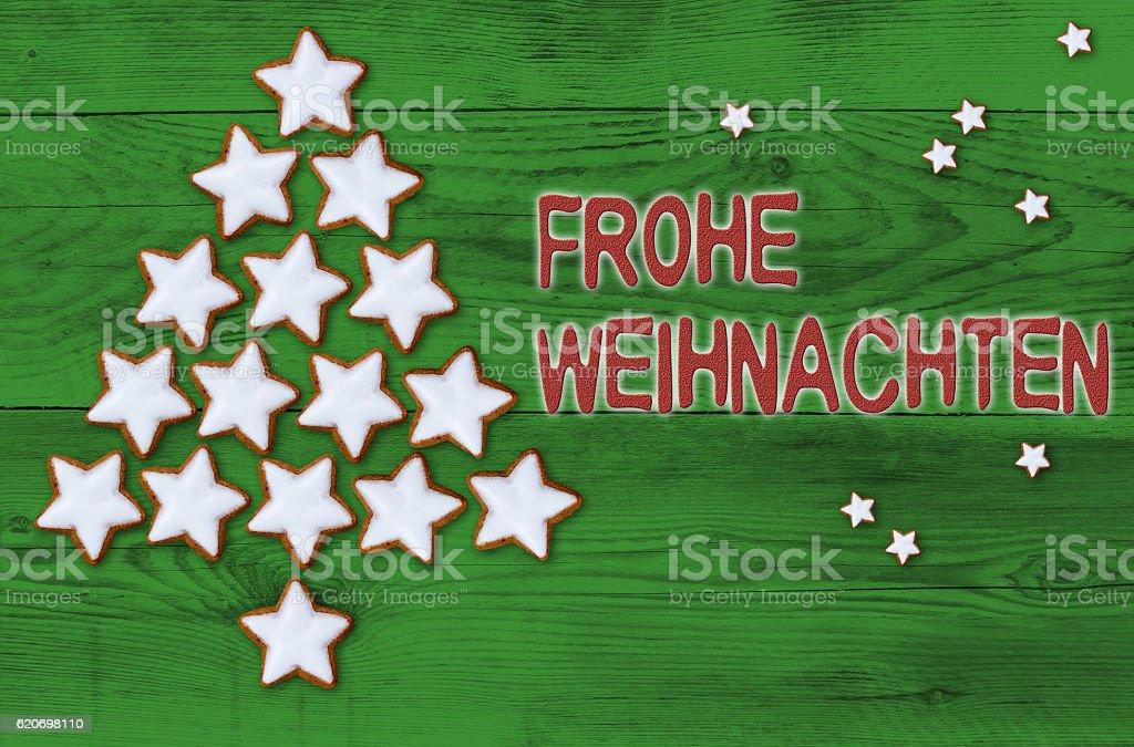 Cinnamon stars Christmas tree Frohe Weihnachten (in german Merry stock photo