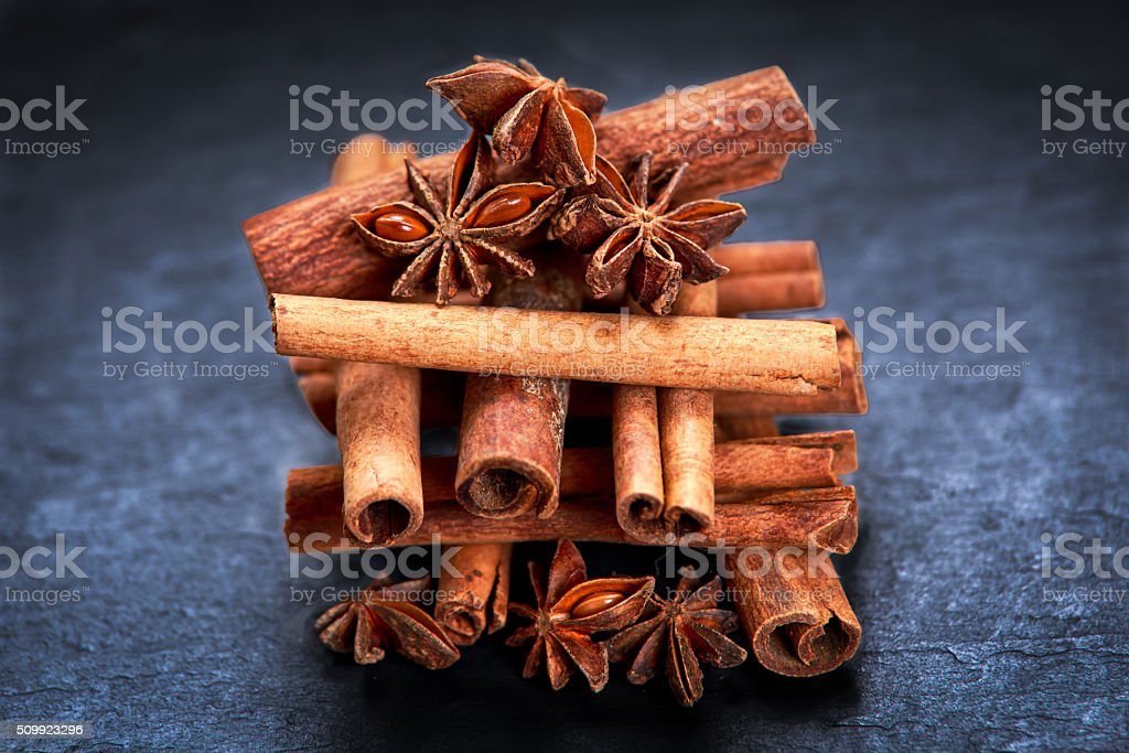 Cinnamon sticks and anice on blue stone background. selected focus stock photo