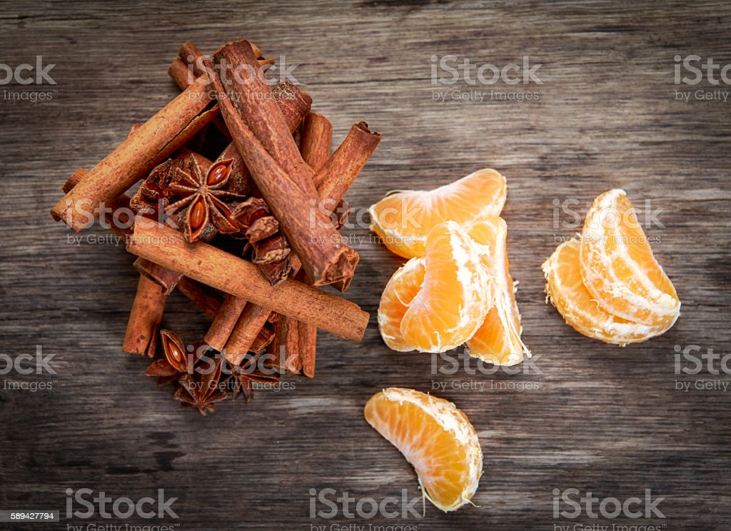 Cinnamon sticks and anice on wooden table. selected focus stock photo