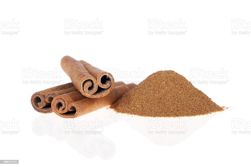 Cinnamon sticks and powder on a white background stock photo