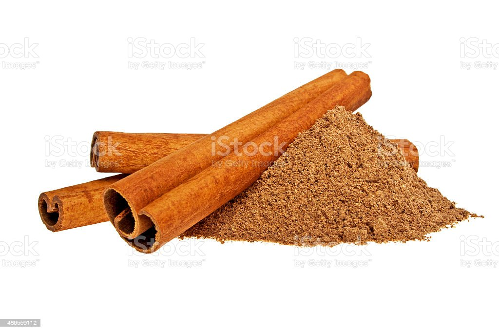 Cinnamon sticks and powder on white background stock photo