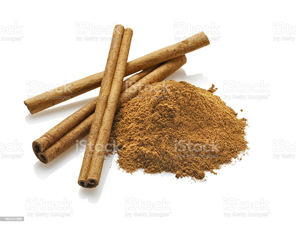 Cinnamon sticks and Powder, White Background royalty-free stock photo