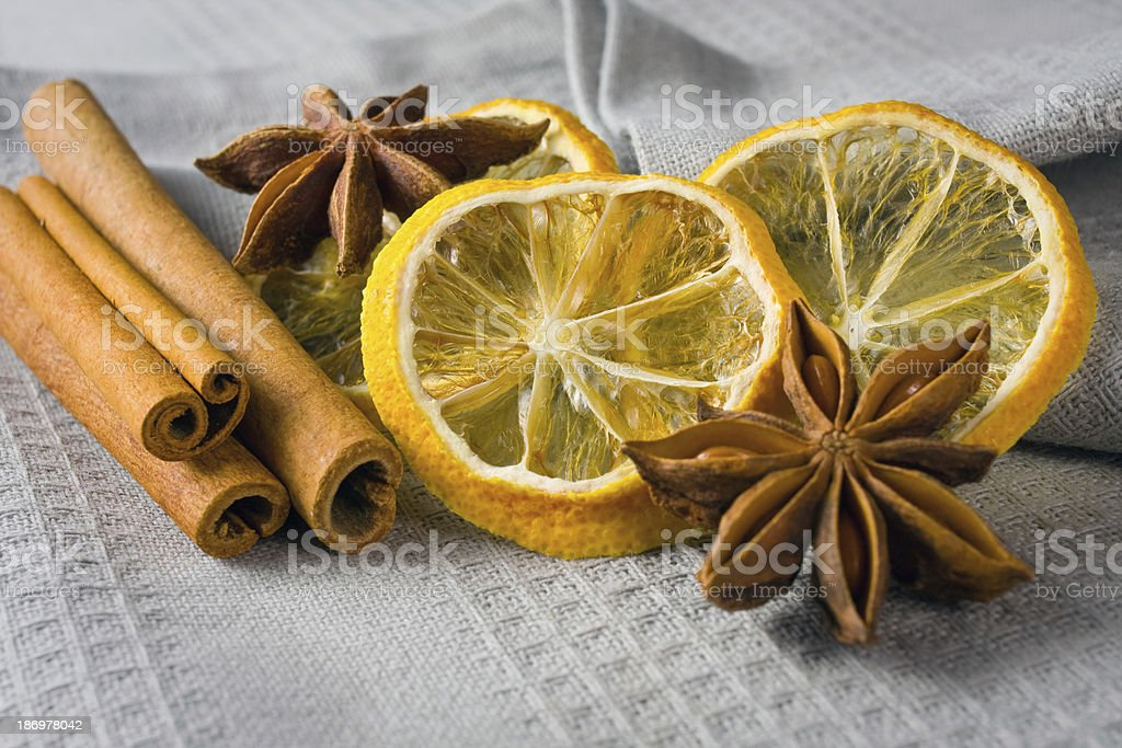 cinnamon sticks, anise stars and sliced of dried citrus royalty-free stock photo