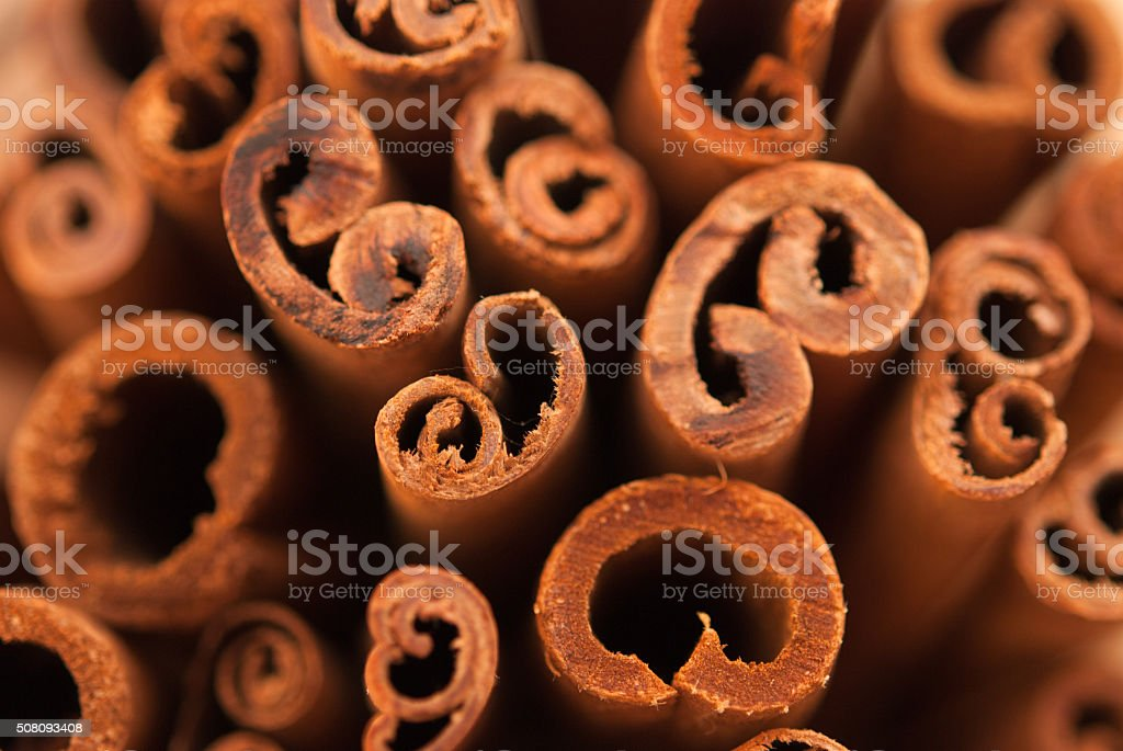 cinnamon sticks as a background closeup stock photo