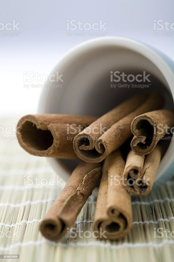 Cinnamon sticks in a cup. stock photo